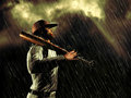 Suspended by the rain baseball player looking at dark sky while is falling Royalty Free Stock Images