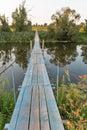 Suspended footbridge over the River Ros, Ukraine. Royalty Free Stock Photo