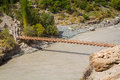 Suspension bridge across a river in the indian himalayas Royalty Free Stock Photos