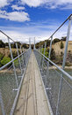 Suspension bridge for a foot trail over the hawea river in new zealand Stock Images