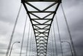 Suspension bridge on a gray cloudy day Royalty Free Stock Images
