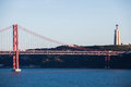 Suspension bridge lisbon the april that links to almada across the river tagus the with it's red colouring Royalty Free Stock Photos
