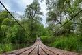 Suspension bridge over river summer landscape Stock Photo
