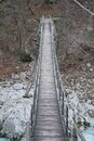Suspension bridge over soca river a wood and rope in slovenia the known as the isonzo in neighbouring italy Stock Photography
