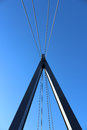 Suspension bridge a is a type of in which the deck is hung below cables on vertical suspenders Stock Photo