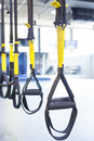 Suspension training suspention straps in fitness studio Royalty Free Stock Photos