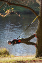 Suspension training on tree man at the outdoor at the river Stock Photography