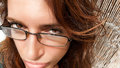 Suspicious glance comic girl expression close up of woman face with glasses and of suspicion fisheye lens Royalty Free Stock Photo