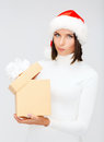 Suspicious woman in santa helper hat with gift box christmas x mas winter happiness concept Royalty Free Stock Photo