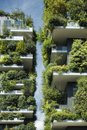 Sustainable architecture, green building with lot of plants on balcony Royalty Free Stock Photo