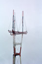 Sutro tower in fog at san francisco california may despite revulsion of residents become icon that appears local art tv shows and Royalty Free Stock Photo