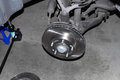 Suv brake rotor replacing or car disk Royalty Free Stock Photo