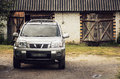 Suv in the country countryside nissan x trail near barn Royalty Free Stock Photography
