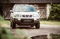 Suv in the country countryside nissan x trail near barn Royalty Free Stock Photos