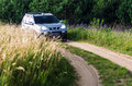 Suv in countryside nissan x trail the forest path Royalty Free Stock Image