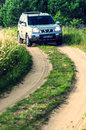 Suv in countryside nissan x trail the forest path Stock Image