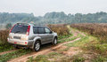 Suv in countryside road Royalty Free Stock Photo