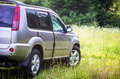 Suv in the meadow countryside nissan x trail Stock Image