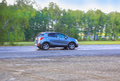 SUV moves on the highway Royalty Free Stock Photo