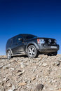 Suv on rocky road image showing a black european a Royalty Free Stock Image