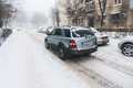 Suv on street in winter driving snow covered Royalty Free Stock Photos