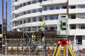 Suveying measuring instrument inside plant total station surveying engineering and construction Royalty Free Stock Image