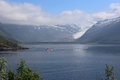Svartisen glacier with rising clouds in Norway Royalty Free Stock Photo