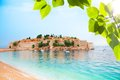 Sveti stefan from the beach beautiful entire peninsula in montenegro with sandy Royalty Free Stock Photo