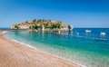 Sveti Stefan island and paradise beach in Montenegro Royalty Free Stock Photo