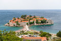 Sveti Stefan island view from hills in windy summer day Royalty Free Stock Photo