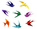 Swallows in origami style Stock Photography