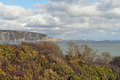 Swanage bay king harrys rock dorset harry s with blue sky and white clouds near view of and headland Stock Image