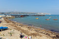 Swanage harbour and jetty dorset england uk with sea and coast on a beautiful summer day Royalty Free Stock Photography