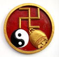 Swastika symbol bali a wall decoration in with a golden a ying yang and a golden bell this is a religious of good luck Stock Photos