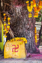 Swastika symbol in the temple on stone and saffron flower garlands near arambol beach goa india Stock Photos