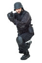 Swat agent a wearing a bulletproof vest and aiming with a gun Royalty Free Stock Photography
