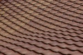 Swaying clay roof terra cotta shingles on a sloping Royalty Free Stock Photos