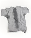 Sweat t a grey shirt with stains under sleeves and through the torso Stock Image