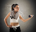 Sweat and toil at gym woman raises a dumbbell weight sweating so much Stock Photos