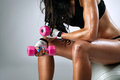 Sweaty female body after exercise sitting on fitness ball Royalty Free Stock Photos