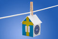 Sweden swedish and eu flag on paper house concept painted a hanging a rope Royalty Free Stock Images