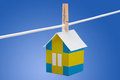 Sweden swedish flag on paper house concept painted a hanging a rope Royalty Free Stock Photo