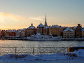 Sweden - winter Stockholm view to Gamlastan from water - single ship near quayside at sunset Royalty Free Stock Photo