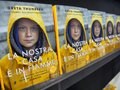 Swedish climate activist Greta Thunberg publish in Italy the book translated as `Our home is burning out` Royalty Free Stock Photo