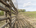 Swedish Farm Fence by Field Royalty Free Stock Photo