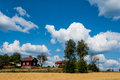 Swedish farm with typical red wooden buildings in the country side of southern sweden in the highlands of småland near ingatorp Stock Photo