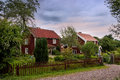 Swedish farm with typical red wooden buildings in the country side of southern sweden in the highlands of småland near ingatorp Stock Images
