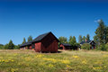 Swedish farm with typical red wooden buildings in the country side of southern sweden smaland near the small town vimmerby in Stock Images