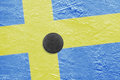 Swedish flag and the puck on the ice a image hockey rink Royalty Free Stock Image