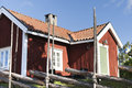 Swedish house a traditional behind an old wooden fence Royalty Free Stock Photos